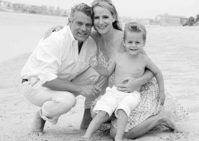 Monochrome photo of family on a beach in Dubai