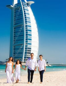 colour photo of family on a beach in Dubai