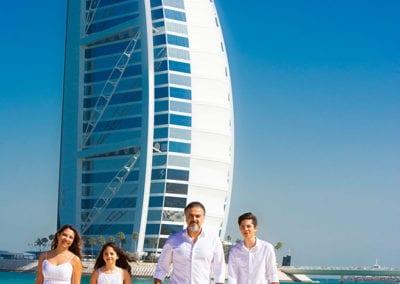 colour photo of family on a beach in Dubai