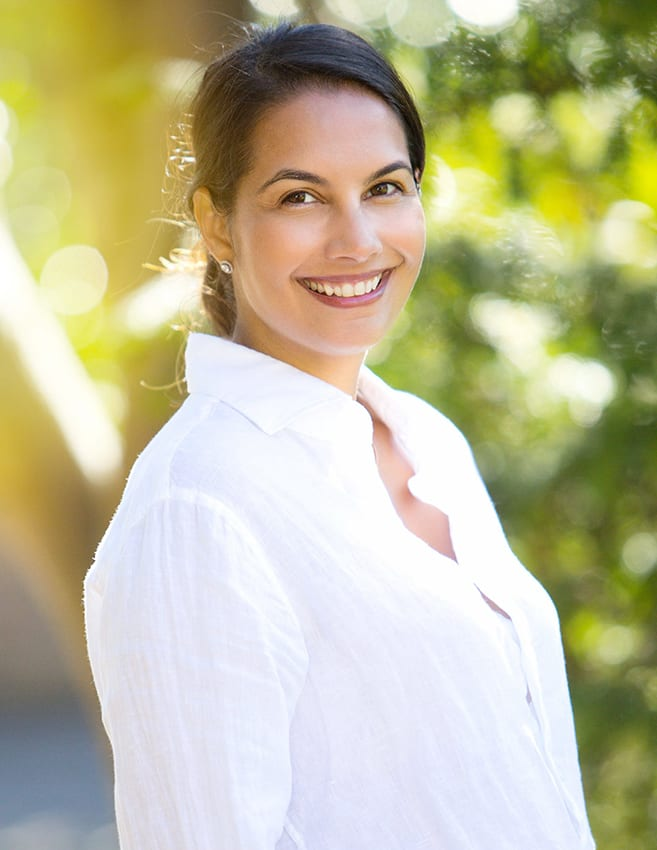 natural light portrait photo of a woman in a white shirt taken in Surrey