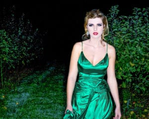 portrait photo of a prom queen in a green dress
