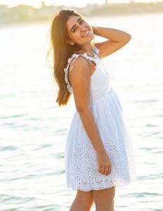 portrait photo of a college senior girl on a beach in Dubai