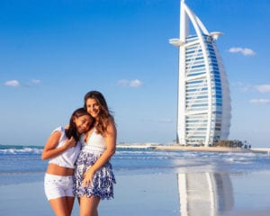 portrait of 2 sisters standing in front of burj al arab