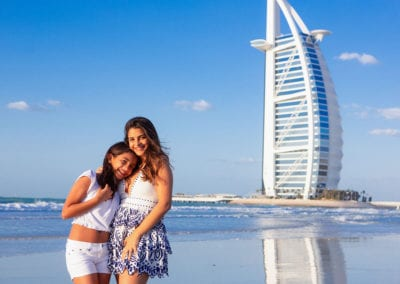 portrait of 2 sisters standing in front of burj al arab