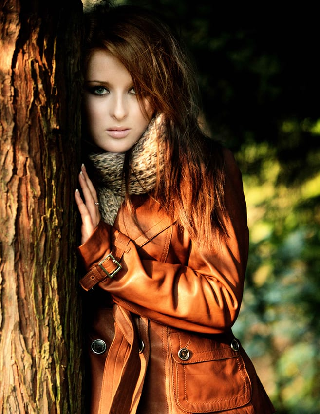 girl standing by a tree wearing a Karen Millen leather jacket
