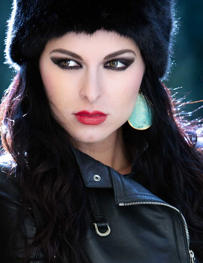 model posing in a Russian hat and leather jacket