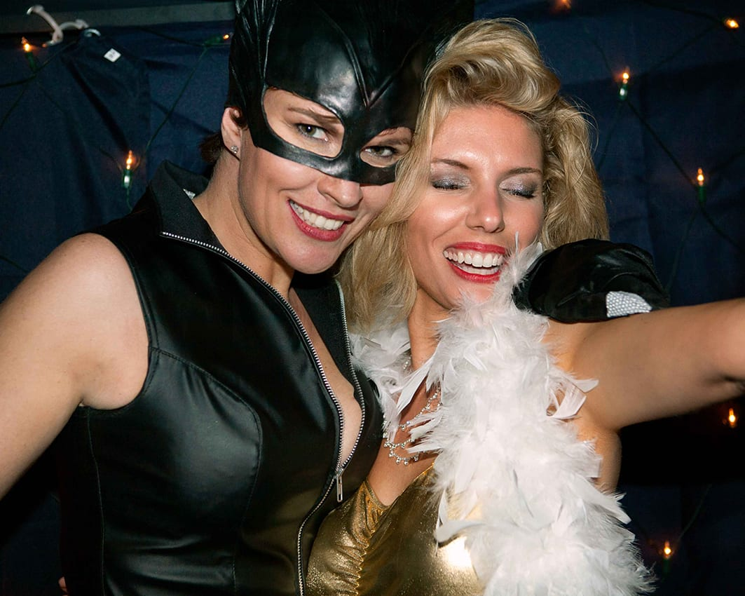 Catwoman and Marilyn Monroe at a fancy dress party